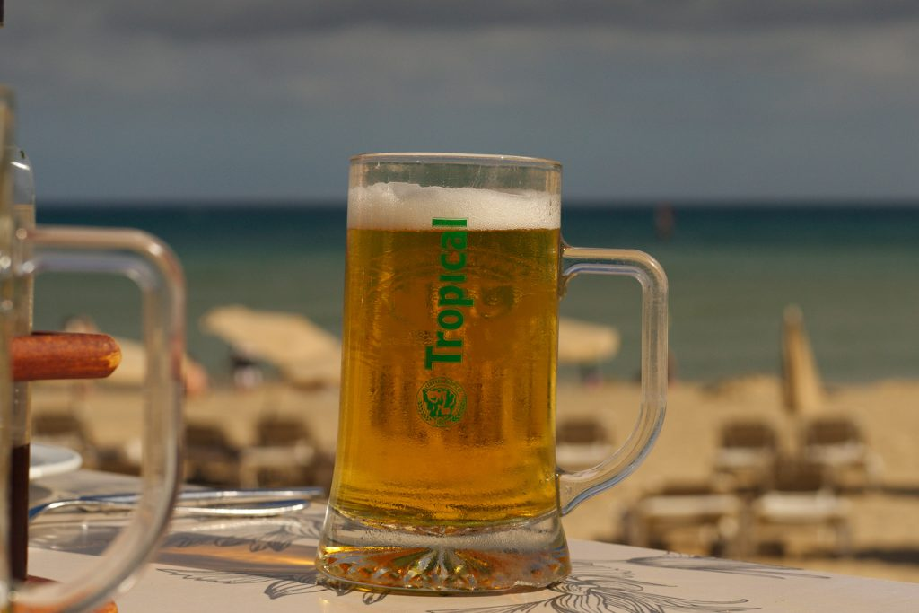 A Jarra of Tropical Beer by the beach.